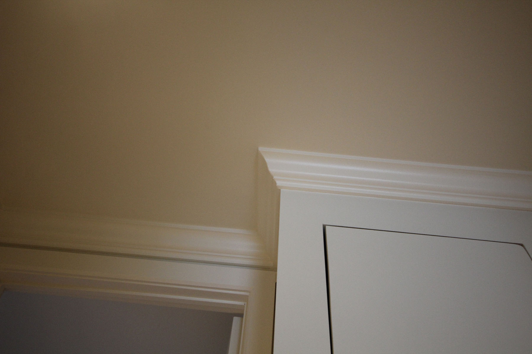 crown mouldings installation services and interior paintain services, baseboard mouldings and quart de rond.